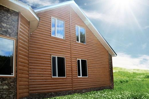 На фото дом с фасадом из металлического блок хауса Гранд лайн