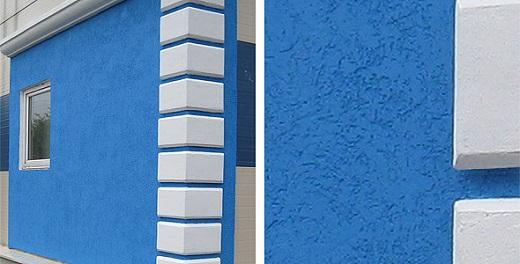 На фотографии показан фасад с нанесенной мокрой штукатуркой