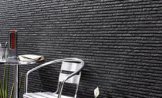 На фото фиброцементные панели под камень на фасаде