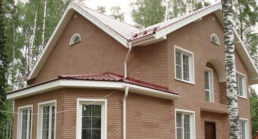 Облицовочная фасадная плитка под кирпич на фасаде этого здания