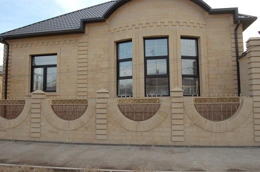 Плитка песчаник для фасада на доме